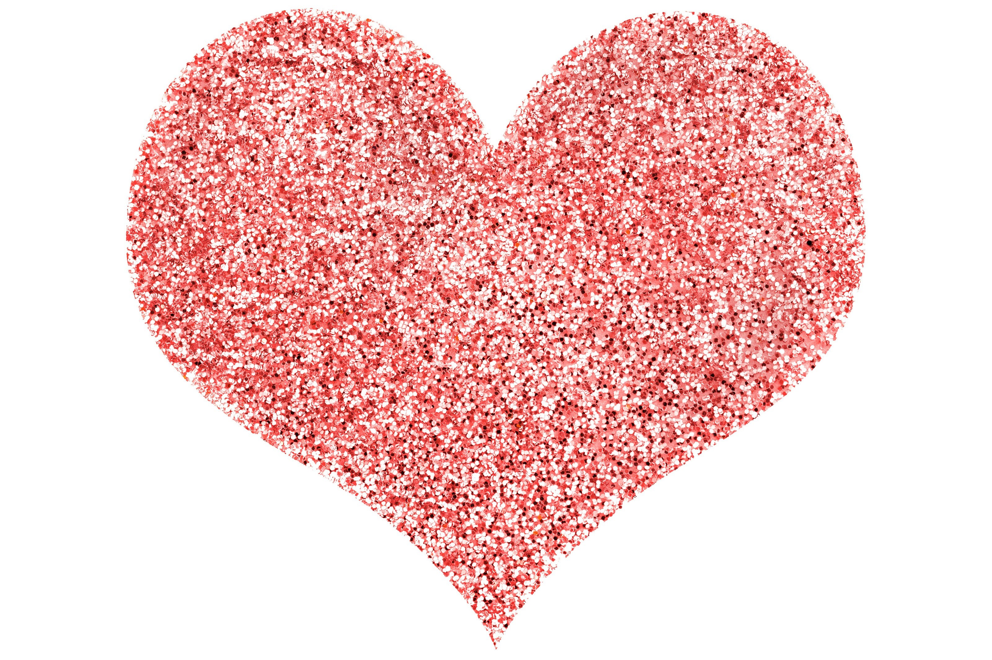 a red love heart shape on white background composed of sparking glitter